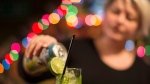 Bar owner makes a drink in a glass at a Toronto bar on Tuesday, December 5, 2017. THE CANADIAN PRESS/Chris Young
