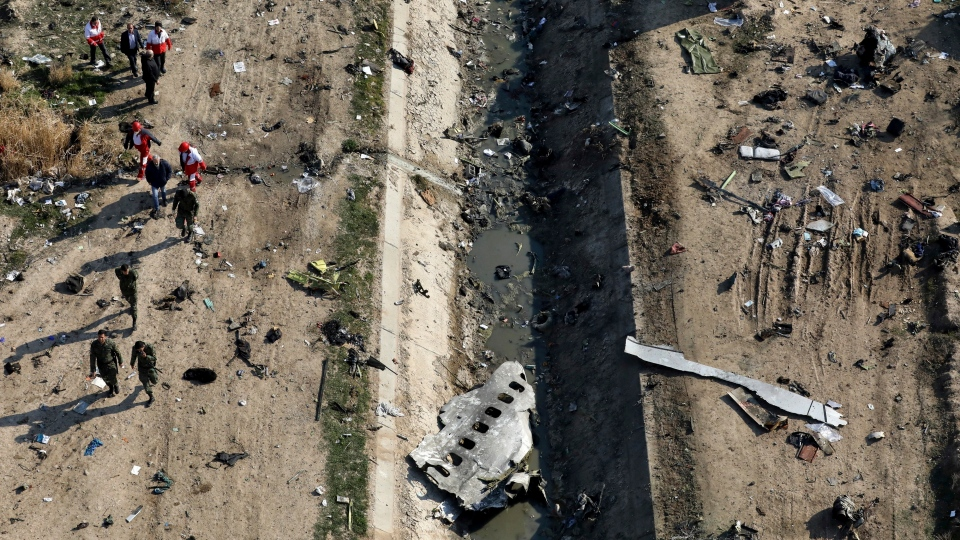 In this Jan. 8, 2020 file photo, rescue workers search the scene where a Ukrainian plane crashed in Shahedshahr, southwest of Tehran, Iran. (AP Photo/Ebrahim Noroozi, File)
