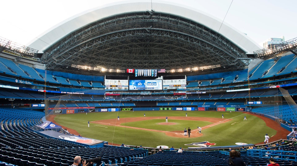Photographers cover the game in an empty stadium during fourth inning Toronto Blue Jays MLB intersquad baseball action in Toronto on Friday, July 17, 2020. THE CANADIAN PRESS/Nathan Denette