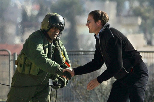 Foreign Affairs Minister Peter MacKay shakes hands an Israeli Army helicopter crewman as he disembarks at a landing pad in Jerusalem on Monday. (AP / Kevin Frayer)