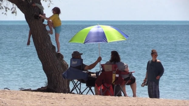 Family enjoying a day at the beach on Saturday.