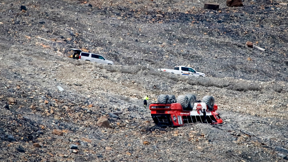RCMP work on the scene of a sightseeing bus rollover at the Columbia Icefields near Jasper, Alta., Sunday, July 19, 2020. Three people were killed and more than a dozen others were critically injured when a glacier sightseeing bus rolled at one of the most popular attractions in the Rocky Mountains, the Columbia Icefield. RCMP said the rollover happened early Saturday afternoon. Pictures posted online by people at the scene showed one of the attraction's big-wheeled ice explorers on its roof down a moraine embankment. THE CANADIAN PRESS/Jeff McIntosh