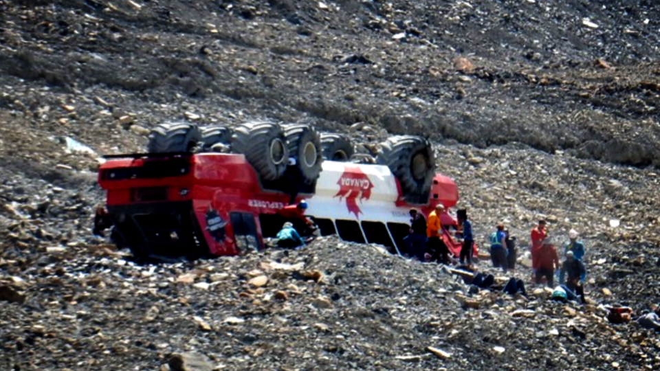 Flipped tour bus at Columbia Icefield