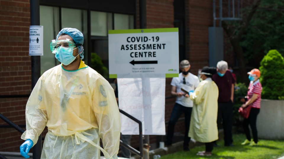 People line up to be tested at a COVID-19 assessment centre in Toronto on Tuesday, May 26, 2020.THE CANADIAN PRESS/Nathan Denette