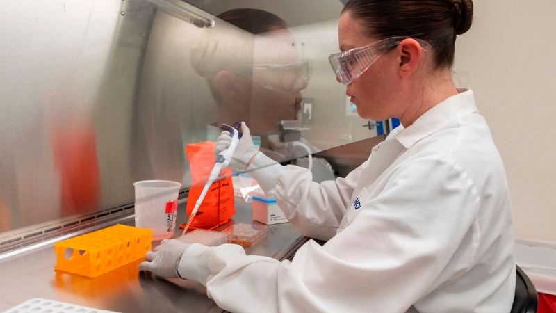 Dr. Rhonda Flores looks at protein samples at Novavax labs in Rockville, Maryland on March 20, 2020 which is one of the labs developing a vaccine for the coronavirus. (ANDREW CABALLERO-REYNOLDS/AFP via Getty Images/CNN)