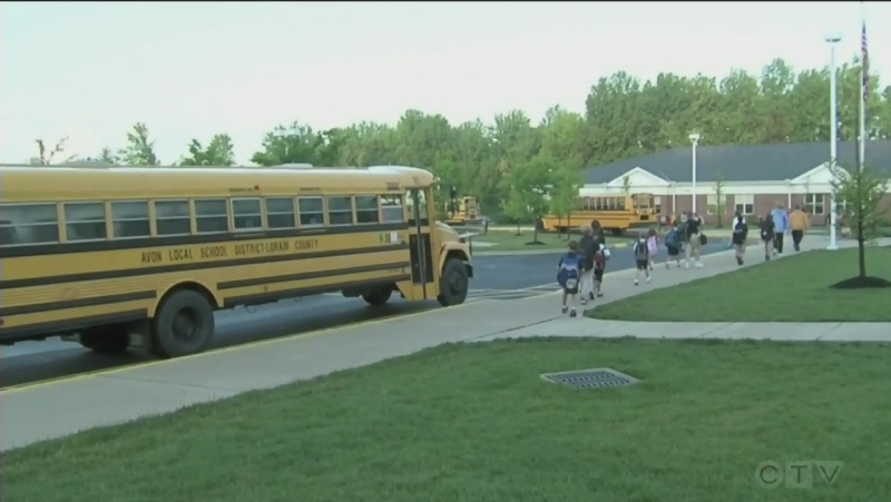 Children arrive at school via school bus