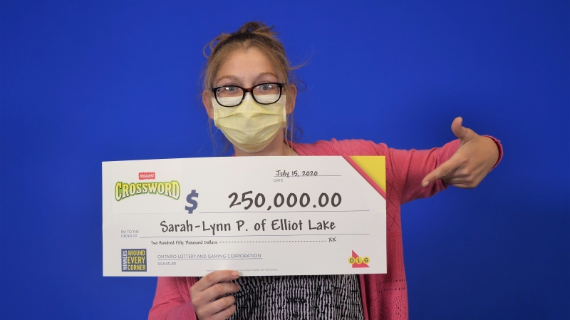 Sarah-Lynn Pearse picks up her $250,000 she won in Instant Crossword. (OLG)