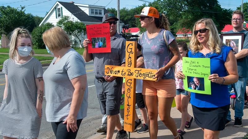 Family and friends of victims attend a march demanding an inquiry into the April mass shooting in Nova Scotia that killed 22 people, in Bible Hill, N.S. on Wednesday, July 22, 2020. (THE CANADIAN PRESS/Andrew Vaughan)