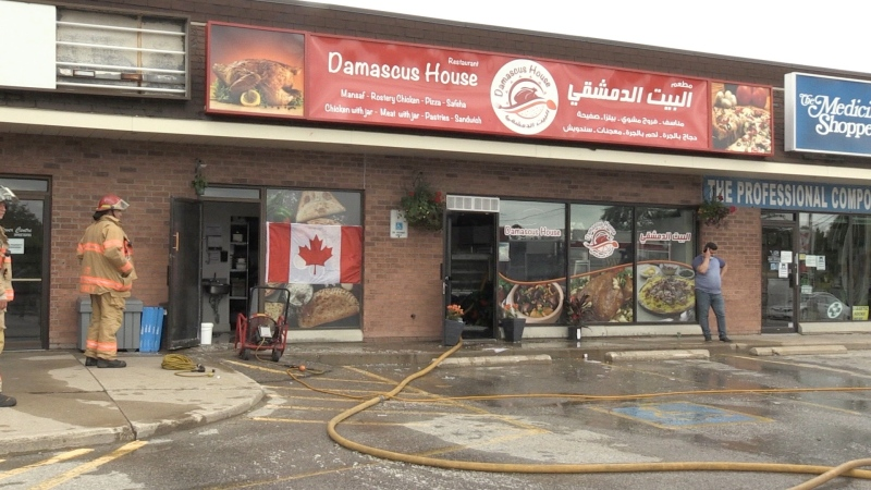 Crews work at the scene of a fire at Damascus House restaurant in London, Ont. on Wednesday, July 22, 2020. (Jim Knight / CTV News)