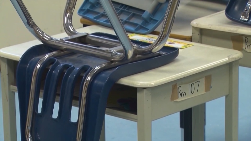 A desk in an empty classroom. (file)
