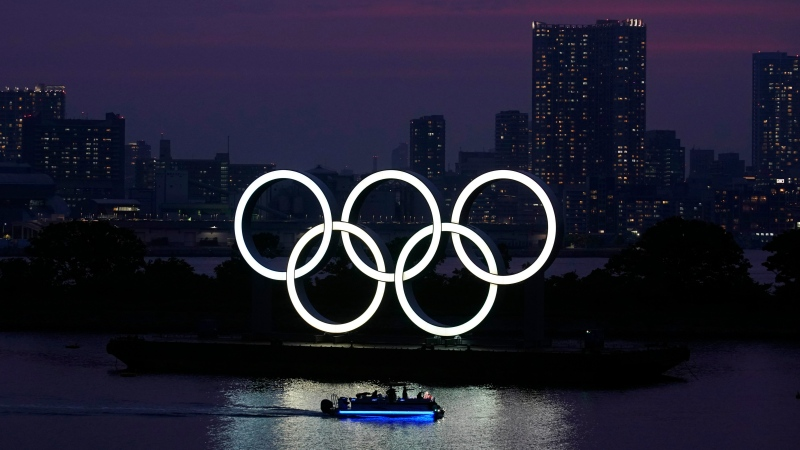 In this June 3, 2020, photo, the Olympic rings float in the water at sunset in the Odaiba section in Tokyo. (AP Photo/Eugene Hoshiko, File)