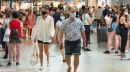 Shoppers wear masks at a mall on the third day of Quebec's mandatory mask order for all indoor public spaces July 20, 2020 in Laval, Que. THE CANADIAN PRESS/Ryan Remiorz