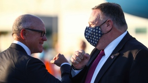 U.S. Secretary of State Mike Pompeo is greeted by Robert Wood Johnson, the United States' ambassador to Britain, as he arrives in Monday, July 20, 2020. (Hannah McKay/Pool Photo via AP)