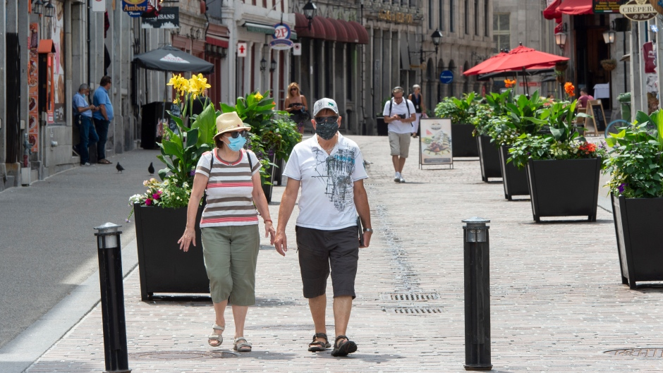 People walk through Old Montreal, Wednesday, July 22, 2020. THE CANADIAN PRESS/Ryan Remiorz