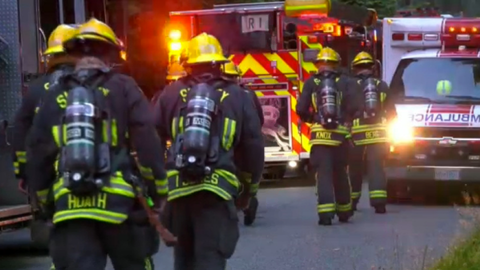 Firefighters respond to an early morning house fire in Surrey, B.C. that left an elderly couple dead on July 23, 2020.