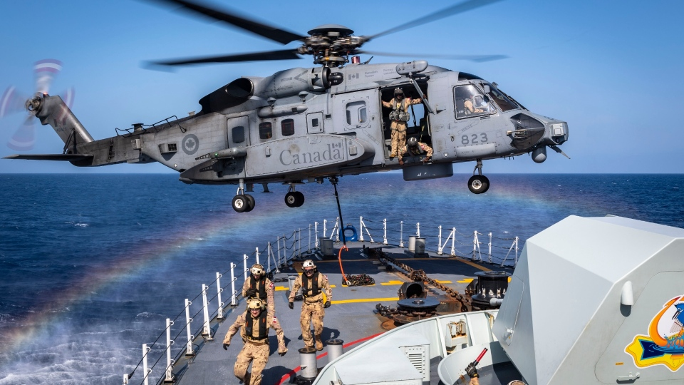 Canadian frigate HMCS Halifax an a CH-148 Cyclone helicopter in the Mediterranean Sea in October 2019. (Corporal Braden Trudeau, Trinity / Formation Imaging Services)