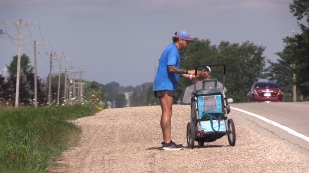 Huron County runner Peter Meades picks up trash and collects it in a child stroller as part of Project Run on July 23, 2020. (Scott Miller/CTV London)