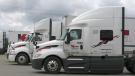 Drivers sit in their cabs at Kriska Transportation in Prescott, Ont. (Nate Vandermeer/CTV News Ottawa)
