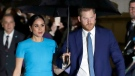 FILE - Prince Harry and Meghan, the Duke and Duchess of Sussex arrive at the annual Endeavour Fund Awards in London on March 5, 2020. The couple are suing to stop the sale of a photo of their son Archie that they say was shot at their Los Angeles-area home in invasion of their privacy. (AP Photo/Kirsty Wigglesworth, File)