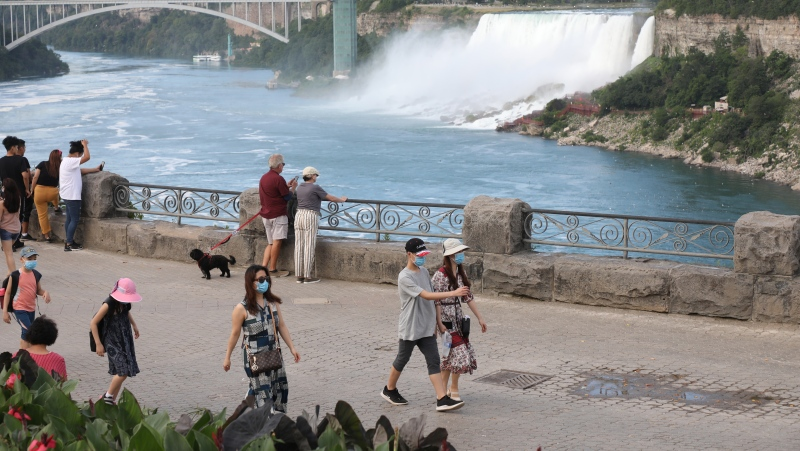 A sparse crowd is seen on the normally jammed walkway in Niagara Falls, Ont., on Monday, July 13, 2020. THE CANADIAN PRESS/Colin Perkel