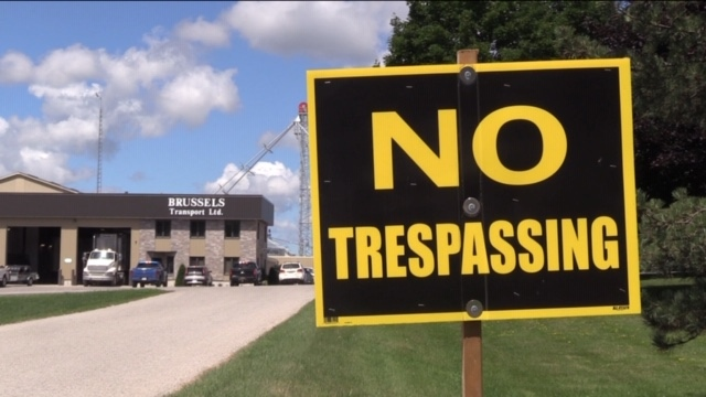 Threats have prompted new signs outside Brussels Transport in Bluevale, Ont. as seen on Friday, July 24, 2020. (Scott Miller / CTV News)