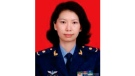 This undated photo provided by the U.S. Justice Department shows Juan Tang in her China People's Liberation Army military uniform. The Justice Department says the scientist lied about her military affiliation in a visa application last October as she made plans to work at the University of California, Davis and again during an FBI interview months later.(Justice Department via AP)