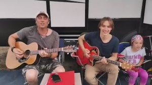 From inside a tent at Twin Lakes, near Moonbeam, Mitch Jean and son Jayden, cover a Keith Urban favourite.