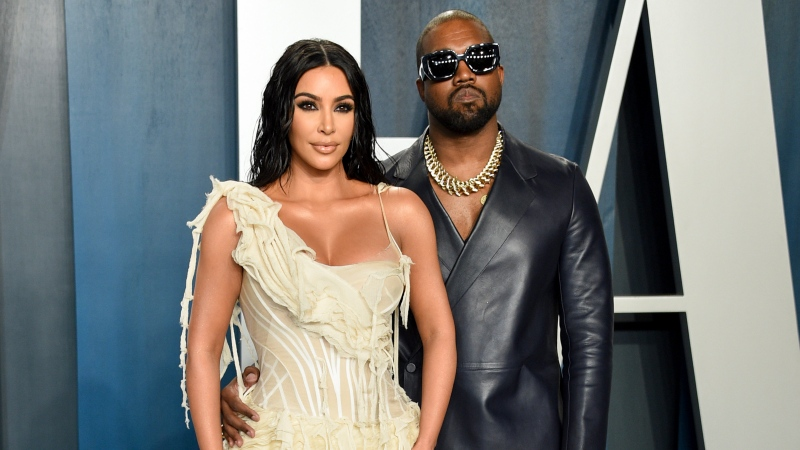 Kim Kardashian West, left, and Kanye West arrive at the Vanity Fair Oscar Party in Beverly Hills, Calif. on Feb. 9, 2020. (Photo by Evan Agostini/Invision/AP, File)