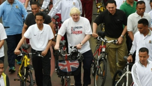 Boris Johnson, seen in his mayor of London days on a visit to Jakarta, says the coronavirus is a 'wake-up call' to the risks of being overweight and junk food advert bans and more biking can help tackle the issue.