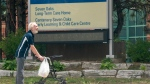 A man takes a walk outside the Seven Oaks Long-Term Care Home in Toronto on Thursday, June 25, 2020. THE CANADIAN PRESS/Frank Gunn