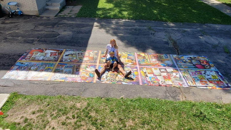 Erin McCafferty poses with the 40,000-piece Disney puzzle she completed in 10 weeks.