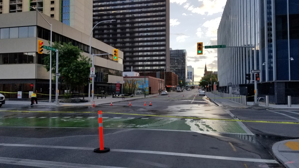 The city was called to Garry Street and St. Mary Avenue for a water main break Sunday evening. (Dan Timmerman/CTV News)
