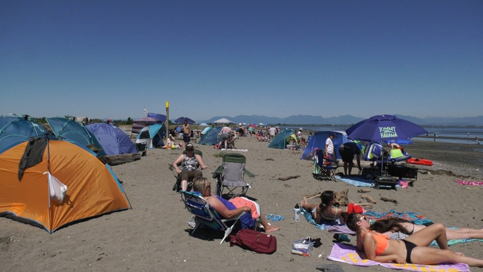 Crowds gather at Delta's Centennial Beach amid a Metro Vancouver heat wave on July 26, 2020.