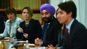 Katie Telford, second from left, chief of staff to Prime Minister Justin Trudeau, takes part in a meeting on Parliament Hill in Ottawa on Sept. 22, 2016. (Sean Kilpatrick / THE CANADIAN PRESS)