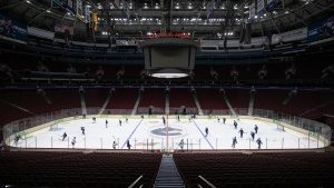 Vancouver Canucks players skate during the NHL hockey team's training camp in Vancouver, on Saturday, July 25, 2020. THE CANADIAN PRESS/Darryl Dyck
