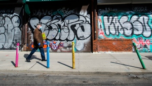 Canadian small business struggling during the COVID-19 pandemic will likely incur $117 billion in debt collectively that could take more than a year to pay off, according to a new study. A lone person walks the empty streets in Kensington Market in Toronto on Wednesday, April 15, 2020. THE CANADIAN PRESS/Nathan Denette