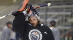 Edmonton Oilers' goalie Mike Smith adjusts his helmet during training camp in Edmonton, Alta., on Tuesday July 14, 2020. THE CANADIAN PRESS/Jason Franson