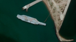 A fake aircraft carrier is seen off the coast of Bandar Abbas, Iran, on June 7, 2020. (Satellite image ©2020 Maxar Technologies via AP)