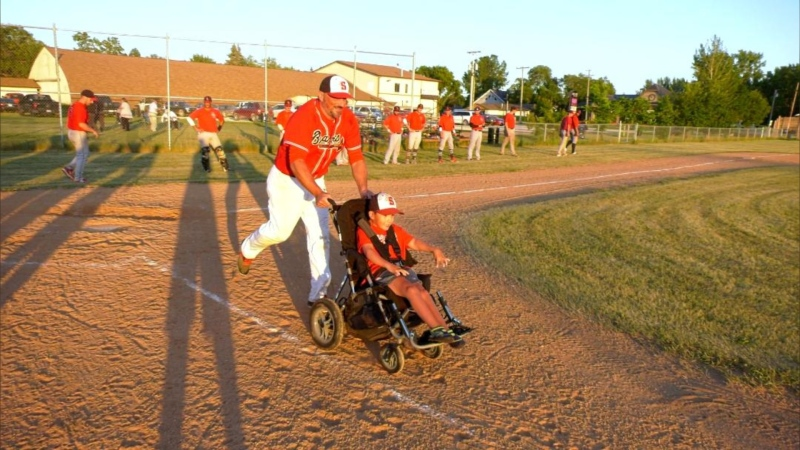 When the game is over, Jacoby picks a Braves player to push him around the bases. (Source: Mike Arsenault/CTV News)