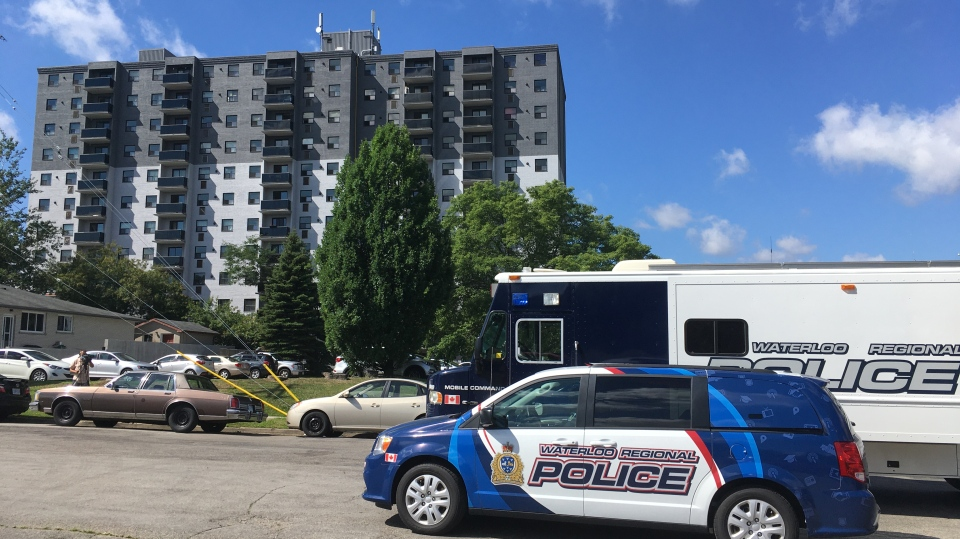 Police vehicles in front of an apartment