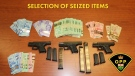 Cash and guns seized during a weapons investigation on the Chippewas of the Thames First Nation on July 26, 2020. (Supplied)