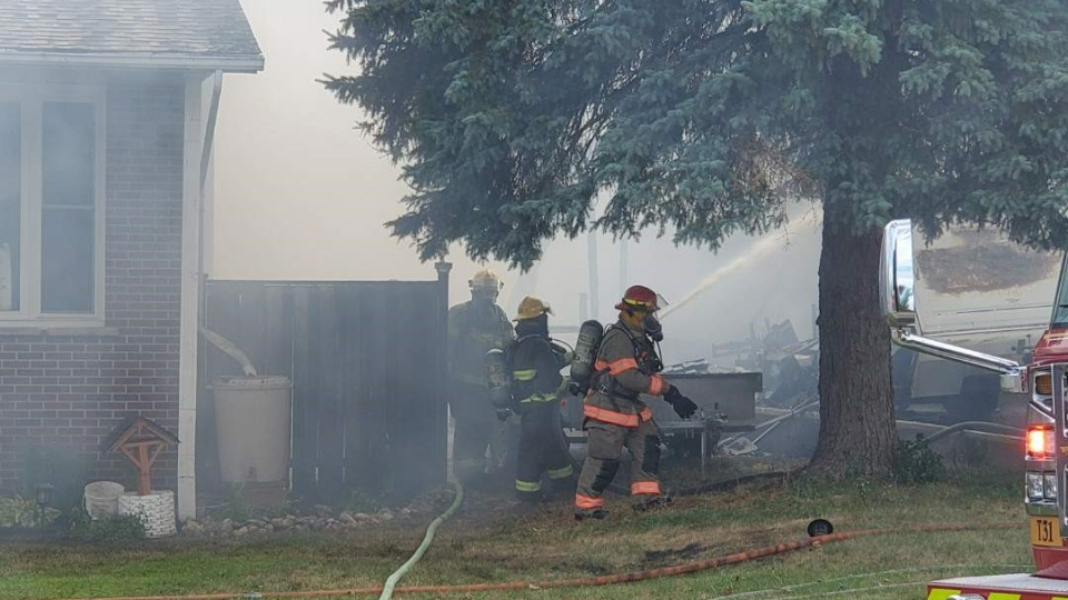 Fire crews respond to a house fire on Rouse Avenue on July 27, 2020
