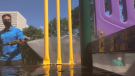 A Dynamo Sanitizing employee sprays down a play structure at the Edgewood Childcare Centre in Vanier. July 28, 2020. (Dave Charbonneau / CTV News)