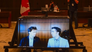 Marc Kielburger, screen left, and Craig Kielburger, screen right, appear as witnesses via videoconference during a House of Commons finance committee in the Wellington Building in Ottawa on Tuesday, July 28, 2020. The committee is looking into Government Spending, WE Charity and the Canada Student Service Grant. THE CANADIAN PRESS/Sean Kilpatrick