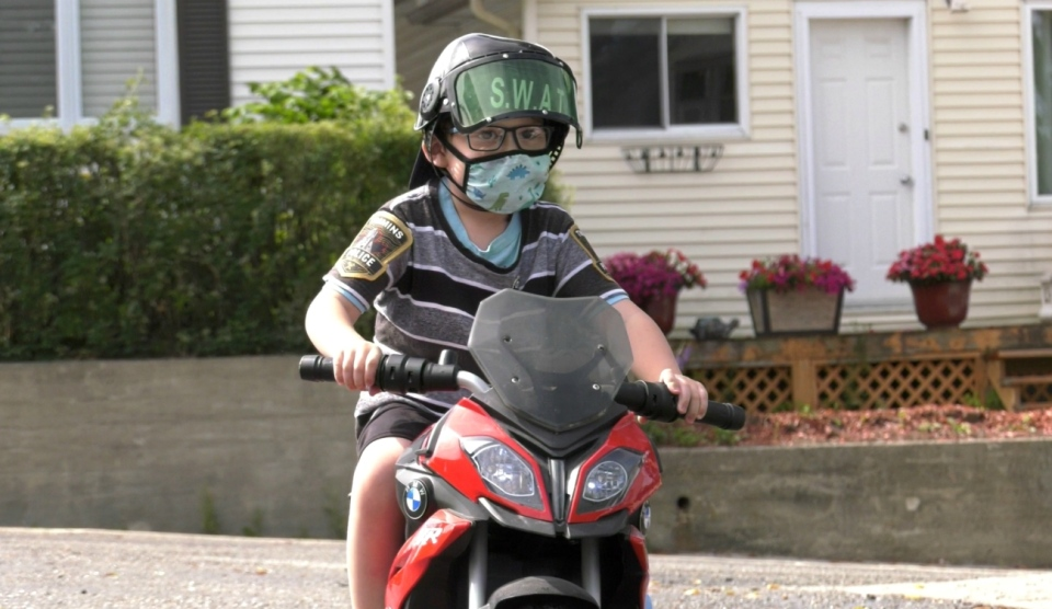 Five-year old Branden Tom patrols his Timmins neighbourhood on his battery operated motorcycle. The Timmins Police Service learned of his efforts and felt he needed to be better identified as a recruit in training. They awarded him with some special apparel and thanked him for his help.  (Lydia Chubak/CTV News)