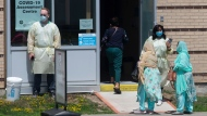 People attend a COVID testing centre at a Hospital in Ajax, Ont., on Tuesday July 28, 2020. THE CANADIAN PRESS/Chris Young