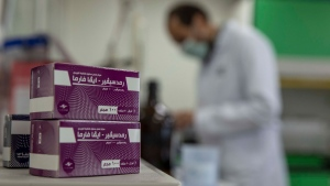Boxes of remdesivir, a medication used to treat the coronavirus, are seen as a lab technician works at the Eva Pharma facility in Cairo, Egypt, Sunday, July 12, 2020. Eva Pharma, a leading Egyptian pharmaceutical company is producing two drugs used in the treatment of COVID-19 patients -- remdesivir for severe cases in intensive care, and avipiravir indicated for moderate cases. (AP / Nariman El-Mofty)