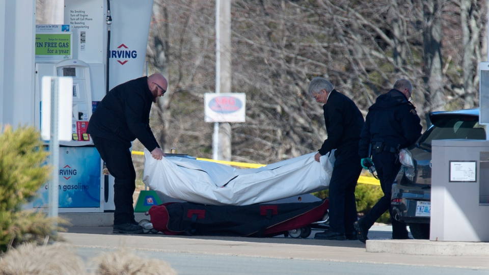 Workers with the Nova Scotia medical examiner's office remove the body of Gabriel Wortman from a gas bar in Enfield, N.S. on April 19, 2020. (THE CANADIAN PRESS/Andrew Vaughan)