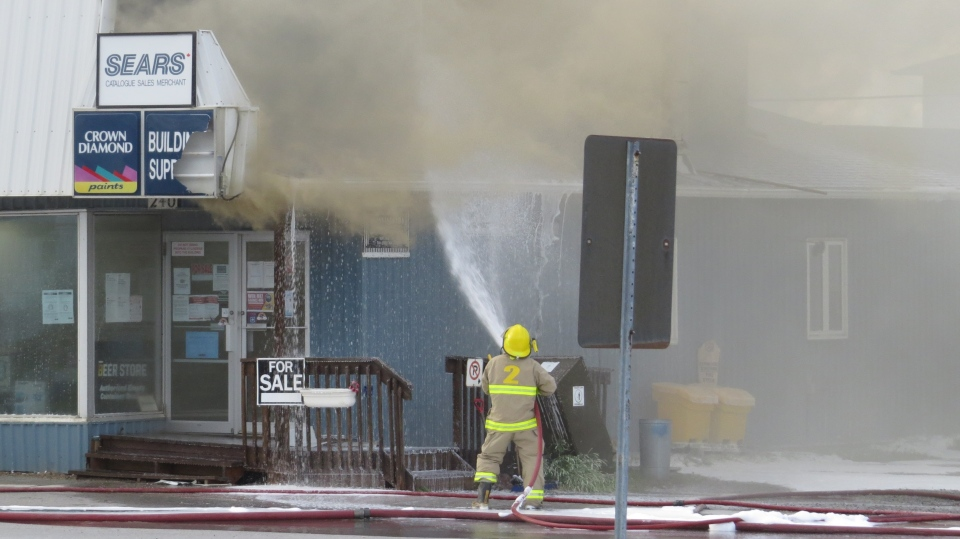 Lone firefighter sprays water on building in Matti