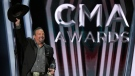 Garth Brooks accepts the award for entertainer of the year at the 53rd annual CMA Awards in Nashville, Tenn. on Nov. 13, 2019. (AP Photo/Mark J. Terrill)